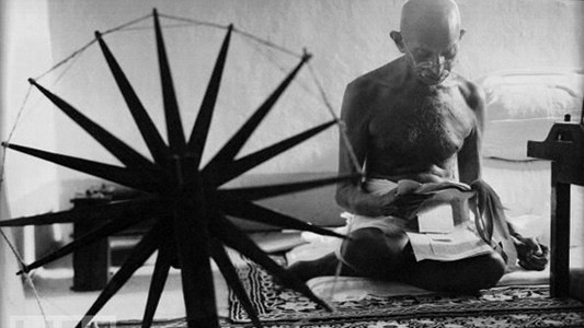 Gandhi.Spinning Cotton for Peace